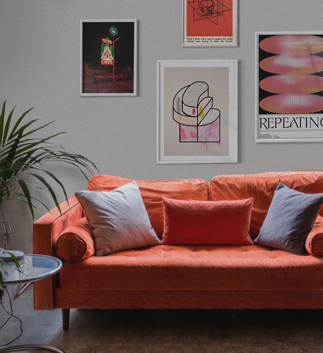 Contemporary Art Prints Displayed In A Gallery Wall With A Modern Orange Sofa