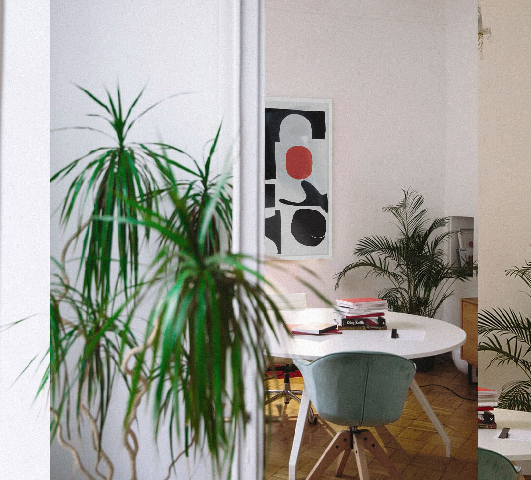 home office with plants and contemporary framed office art