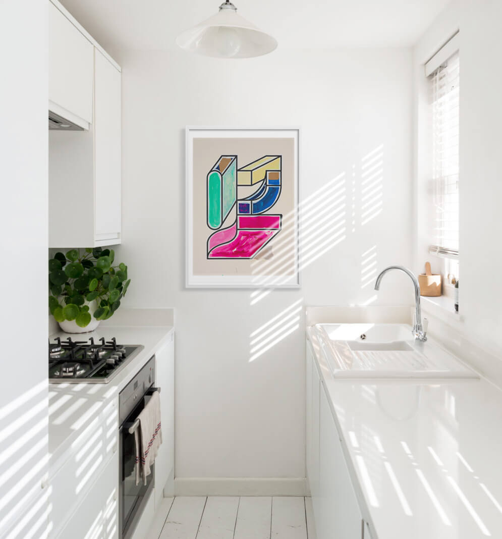colourful framed art print in a white kithchen