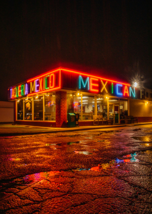 photo of a Mexican restaurant's bright neon sign