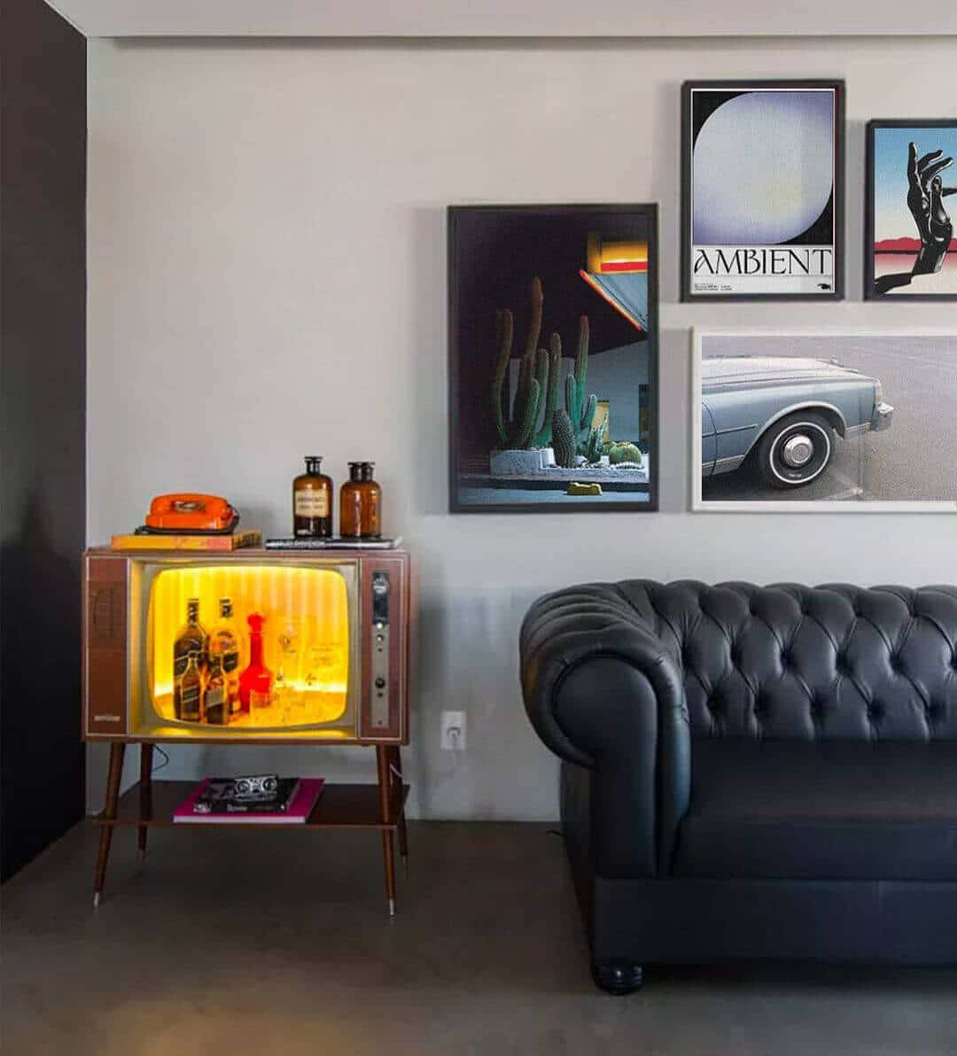 Maximalism Interior with a black leather sofa and contemporary gallery wall