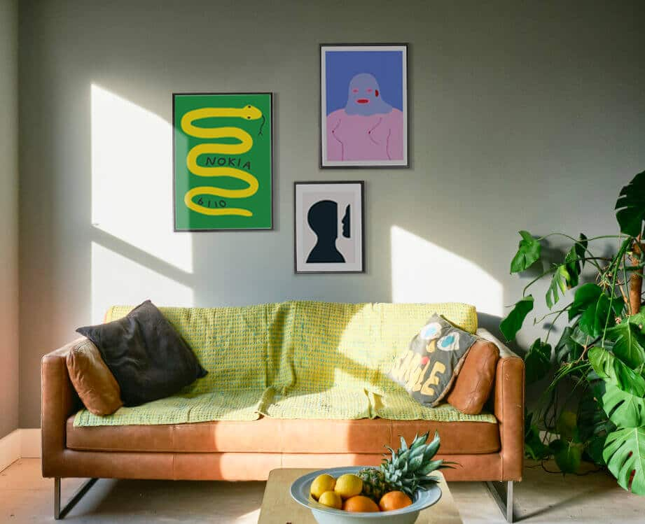 framed artworks hung on the wall of a london flat
