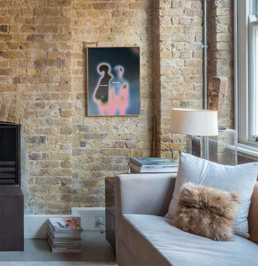 Illustration Artwork Framed On An Industiral Styled Living Room Exposed Brick Wall