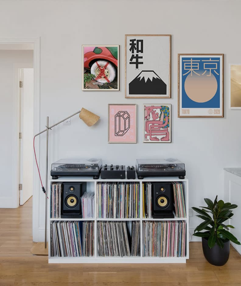 Midcentry Modern Living Room Featuring A Gallery Wall And Dj Decks