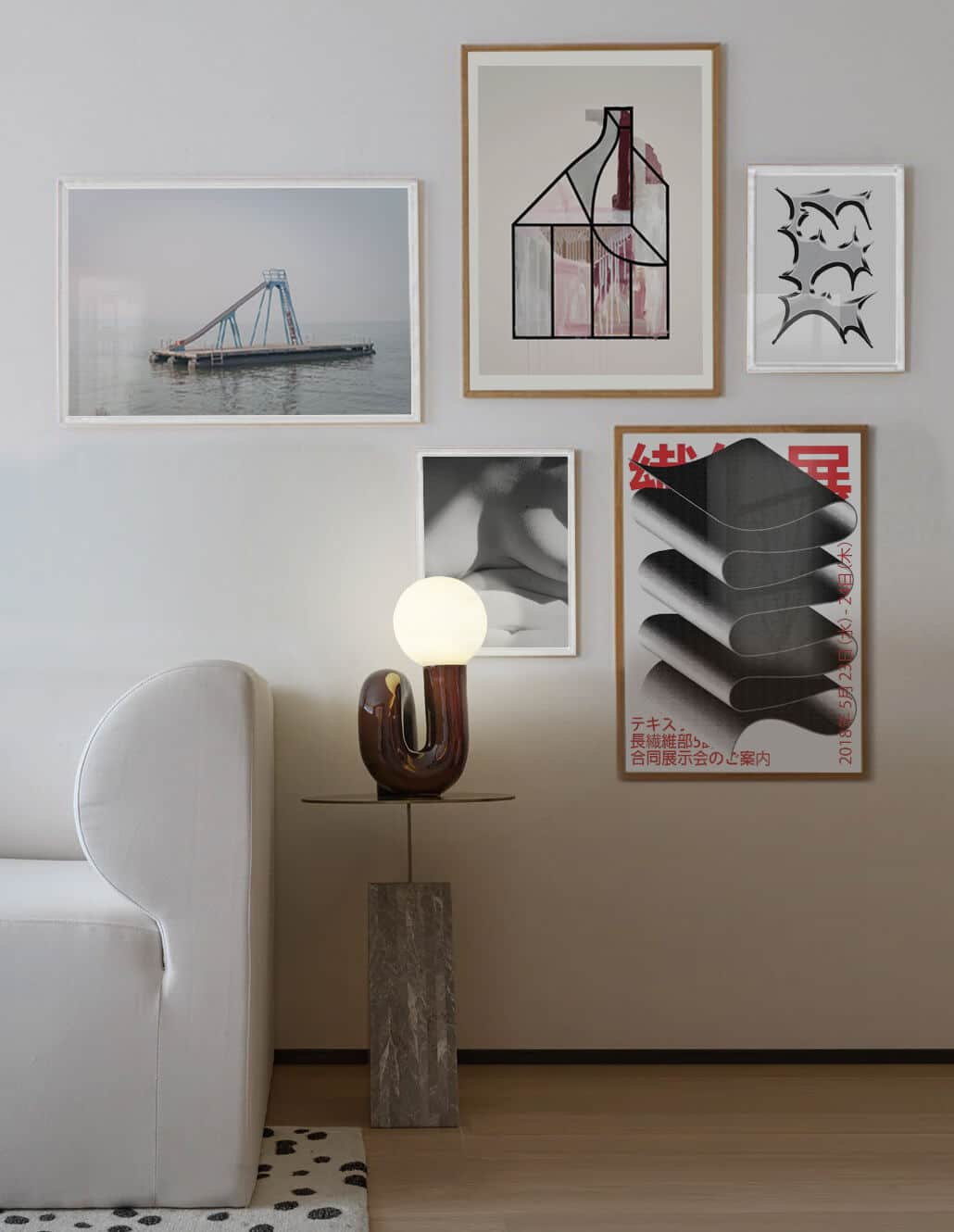 muted gallery wall hung on the wall of a chic living room interior